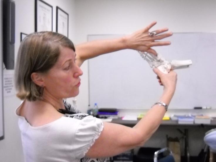 Dorthe demonstrating side thumb technique. www.AmericanAcademyofReflexology.com