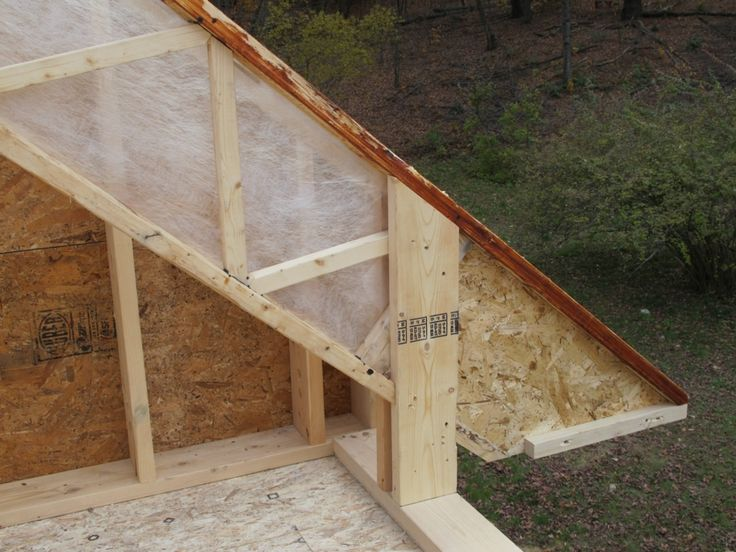 """We think the fabric will help us achieve complete filling of the rafter cavity with fiber insulation. You can see the """"foot"""" on the rafter in this photo."""