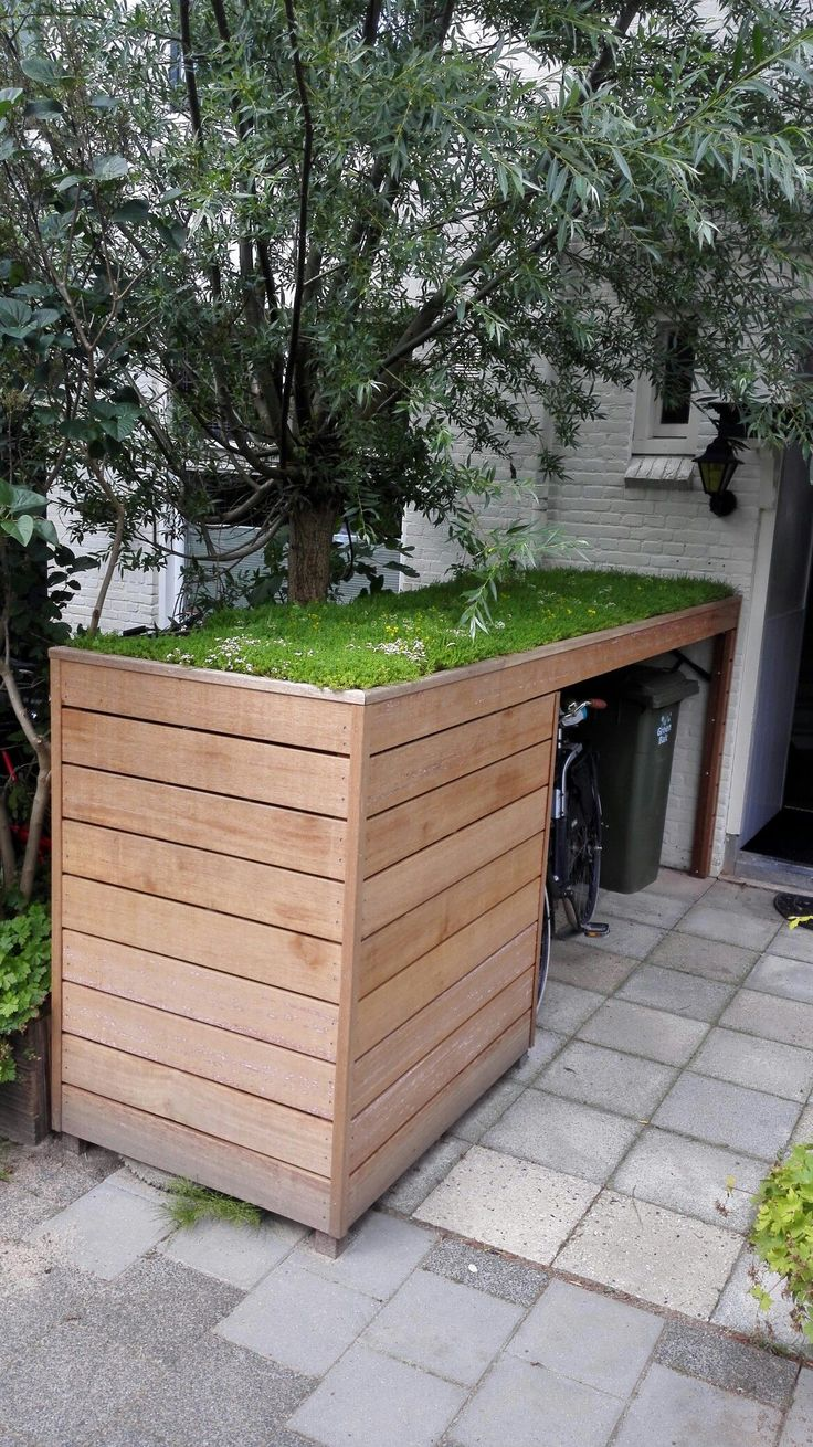 Fietsenberging met sedumdak http://www.uk-rattanfurniture.com/product/deluxe-waterproof-6-seat-rattan-cube-cover-garden-furniture-rain-protector-cover/ #greenroof