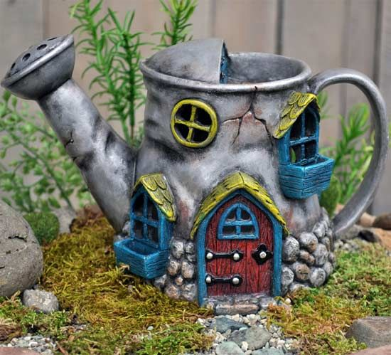 Old Watering Can Fairy House is a cozy home for all fairy lovers' gardens.