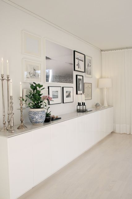 I like this idea for the master bedroom instead of several pieces of furniture. One long sideboard. Interesting thought