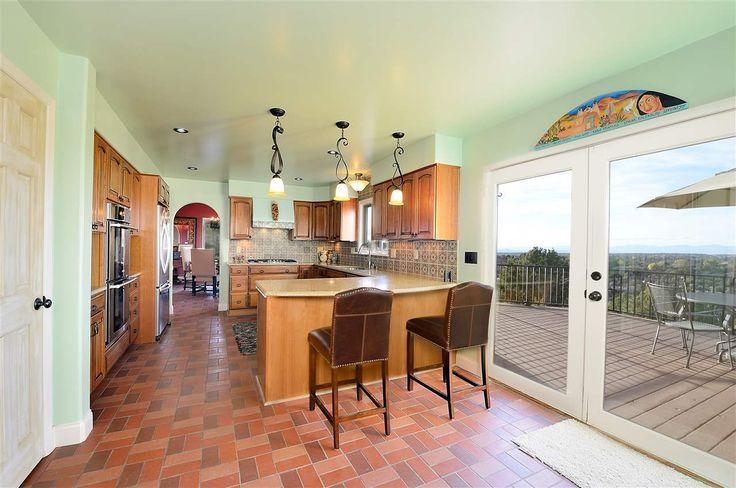 976 Indian Rdg, Santa Fe, NM 87501 - Photo 6 of 23 - COOL TILES ABOVE GLASS DOORS