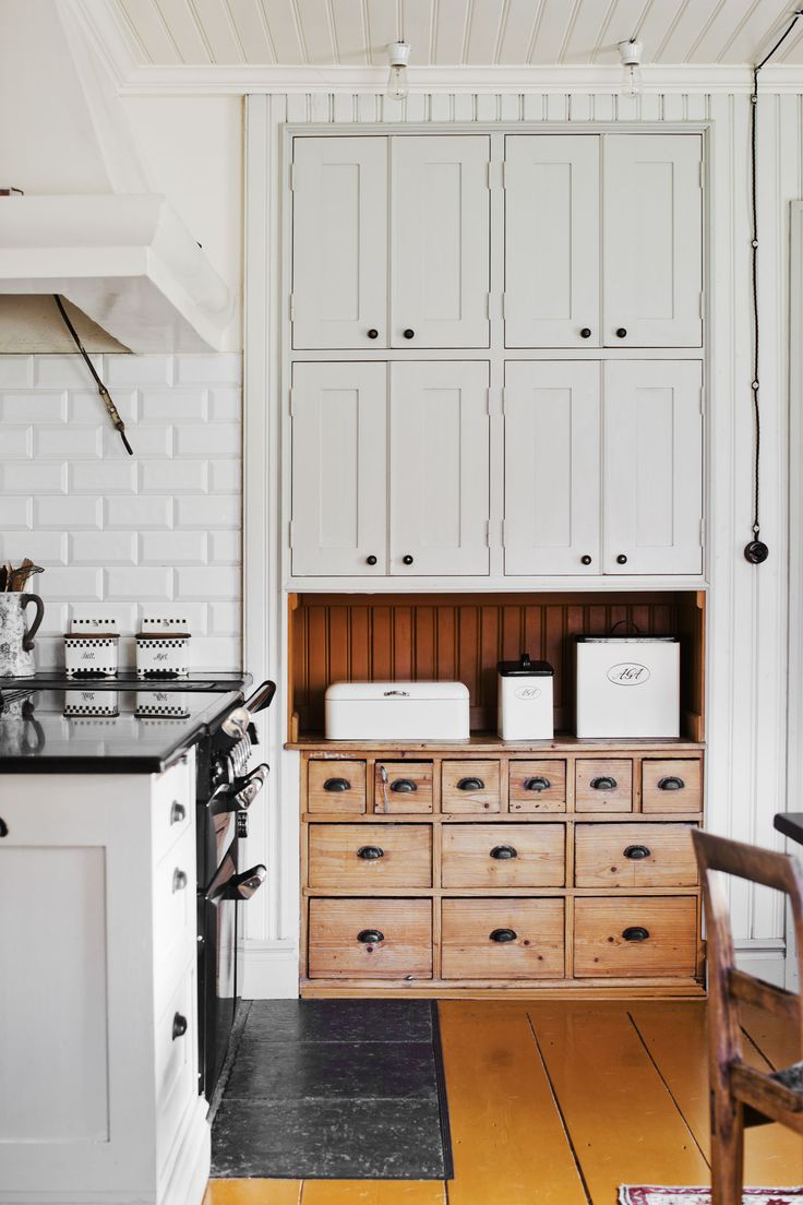 LOVE the vintage wood cabinets on the bottom with neutral cabinets up top and white tile