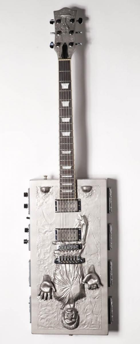 Hans Solo Frozen in Carbonite guitar - stringed instrument, rectangle body. Based on film STAR WARS, musician's theme! #DdO:) MOST POPULAR RE-PINS - Other Music related  Funky Mood Lifters to give a laugh at #Pinterest board https://www.pinterest.com/claxtonw/humor-pics/ OR at http://www.pinterest.com/DianaDeeOsborne/funky-mood-lifters - REFRIGERATOR shows  poor Harrison Ford's character trying to escape just before locked into Time. An  INSTRUMENT for Joy & laughs! Photo pin via Todd…