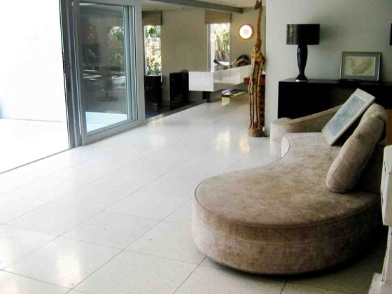 This stylish #lounge area is infused with natural light reflected on the cool, classic slim line #Terrastone #terrazzo tiles from #UnionTiles