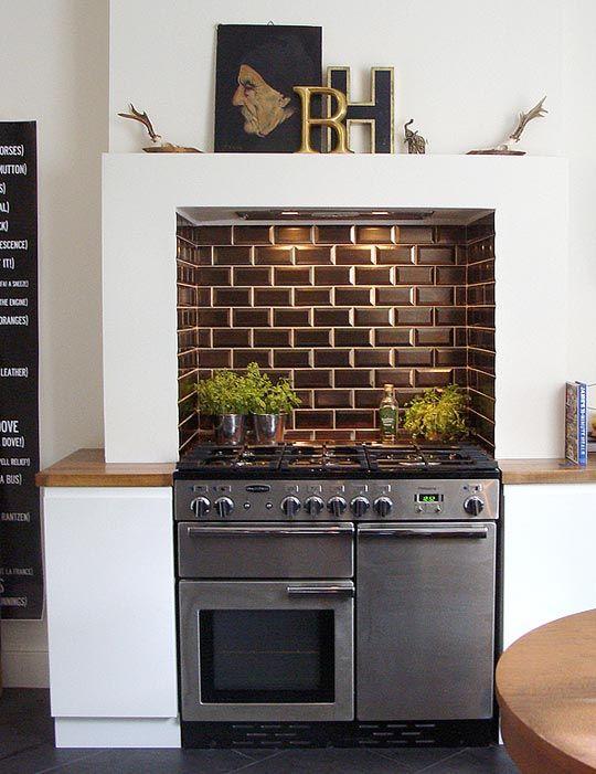 Kitchen stove set in mantel.
