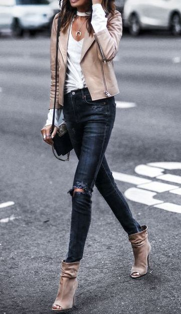 love her style. a must nude leather jacket + black skinny jeans and booties. fall street style.
