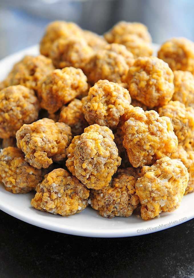 These Sausage Balls are the perfect savory bite for serving at parties. This recipe is easy and made without baking mix. shewearsmanyhats.com