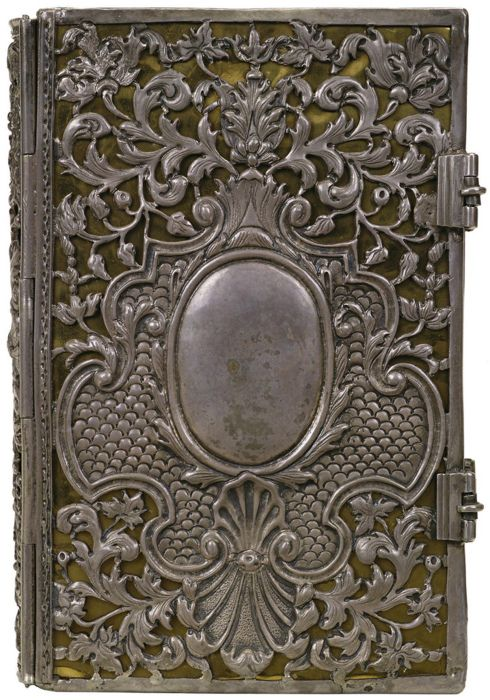 scrolled silver book