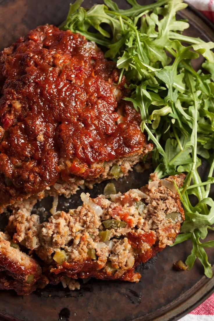 Homemade meatloaf with brown sugar glaze is flavorful, easy and never greasy. Tomatoes, onions, peppers and that brown sugar glaze! Amazing! via @contessa_cooks