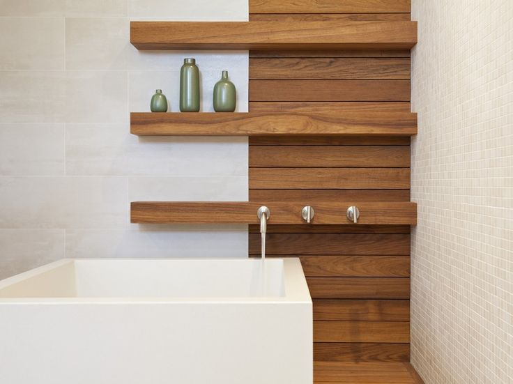 These beautiful open shelves add great storage space and a cool design element to this modern bathroom.