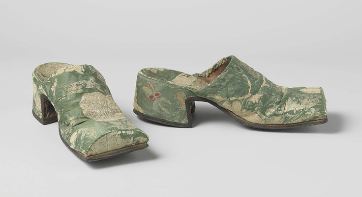 Pair of man's mules, The Netherlands, c. 1700-1715. Green flowered silk brocade embroidered with floral motifs in gold and red, leather.