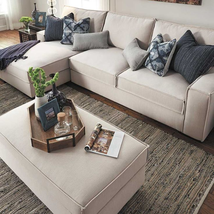 The Kendleton Stone Chair 2PC Sectional Sofa w/ LAF Chaise from the Kendleton Stone Collection by Ashley Furniture beautifully blends retro sensibility with contemporary taste. The stone-colored linen-look fabric and the flange welt along the seams create a crisp, designer feel, while the large chaise lounge and deep seating allow you to curl up and get comfortable.