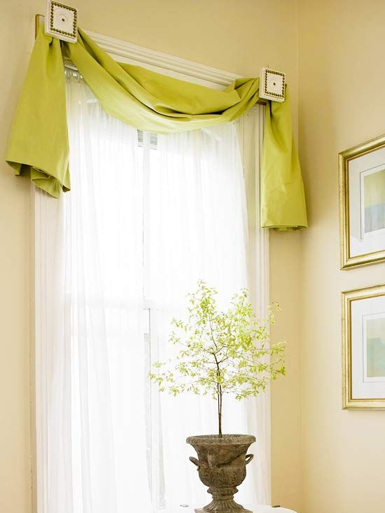 Simple Swags:Scarf, slung fabric strip, unlined or lined, draped over a decorative rod or wound over a tieback at each top corner of a window frame.The middle of the fabric strip acts as a valance; the ends, whether cut into opposing diagonals or simply hemmed, softly hang down the sides of the window.  It's most appropriate used alone on windows where privacy is not an issue.