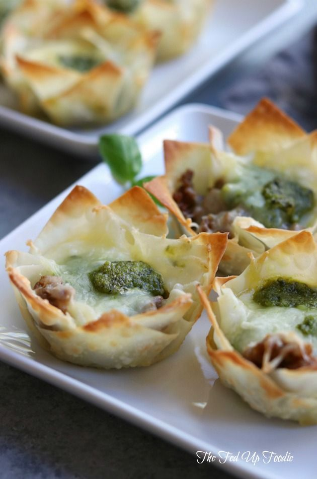 Crispy, cheesy and bursting with flavors of Italian sausage and pesto, these Italian Cheesy Bites are a wonderful appetizer for your Holiday get togethers. #FallFest http://www.thefedupfoodie.com