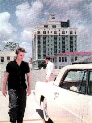 elvis presley 21 looks over a new lincoln continental mark ii cadillac in mia. Black Bedroom Furniture Sets. Home Design Ideas