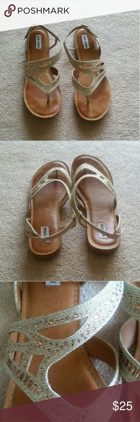 Not Rated sandals Beautiful Not Rated sandals. Cream color with rose gold rhinestones. Has buckle on the back to tighten or loosen. Only worn once, in perfect condition! Size 11 but fits like 10 (which is why I posted them as 10) Not Rated Shoes Sandals