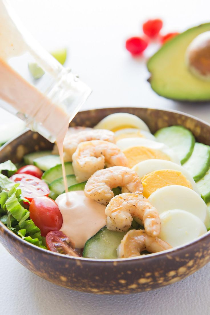 This fresh and vibrant Shrimp Louie Salad consists of a bed of lettuce topped with avocado, hard boiled egg, tomato, cucumber, and seared shrimp. Topped with the signature Shrimp Louie dressing this salad makes a delicious lunch meal. All tossed up, it could also be a great summer BBQ side dish.