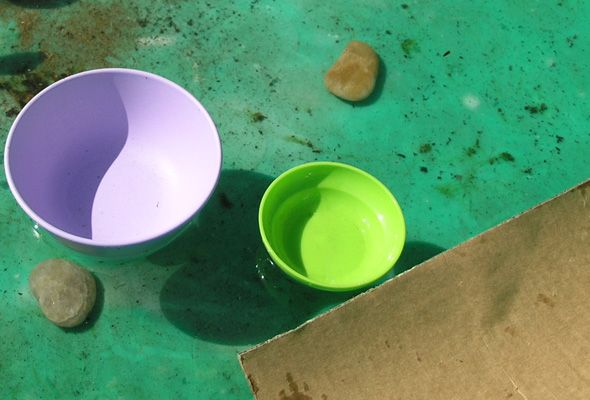 Recently we headed outdoors to do some gardening and while we were outdoors Immy discovered that her plastic paddling pool had partially filled with rainwater. I was working close by (pulling weeds...