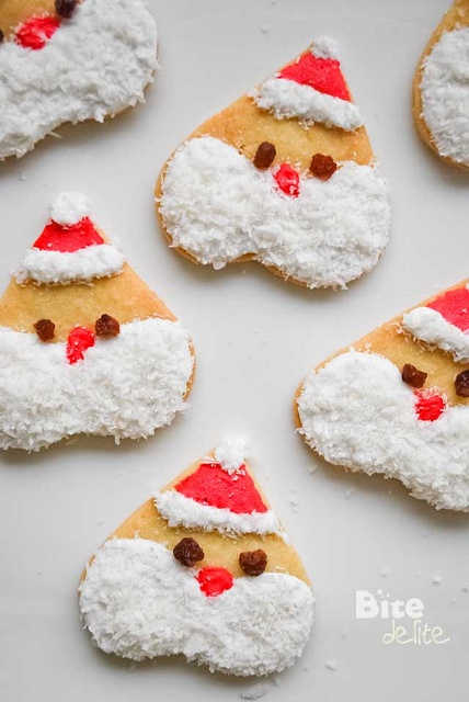 Adorable Santa Cookies using a Heart Shaped Cookie Cutter!  http://bitedelite.com/2011/12/santa-cookies/