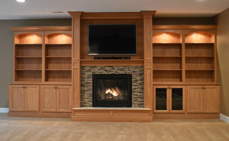 Fireplace Unit Surrounded By Custom Wall Built Ins