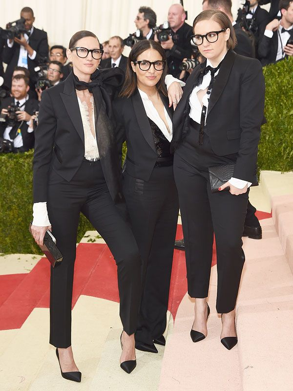 The trio accessorized with Lyons' signature thick-rimmed glasses...
