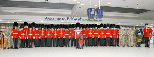 The 1st Battalion Irish Guards caused a bit of a stir when all 40 of them arrived in full regalia at Belfast International Airport check in hall along with their mascot, Irish wolfhound, Donal. The battalion are in Northern Ireland to attend the Armed Forces day at Carrickfergus on Saturday 28th June.