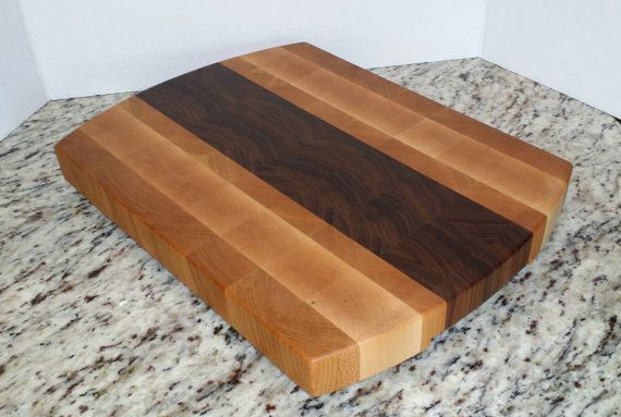 You will receive the board pictured.  This end grain cutting board board is constructed of Cherry, Maple and Walnut hard woods. Rubber-padded feet have been added to help maintain stability and prevent slipping while being used. It has been finished with MCT oil (from coconut oil) and beeswax.  Dimensions: Millimeters 400mm x 300mm x 38mm Inches 15.75 x 11.8 x 1.5