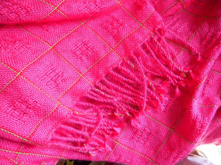 """Hot pink mohair blanket in plain weave and Swedish """"mosquito lace"""".  Woven and photographed by Holly Hardman."""