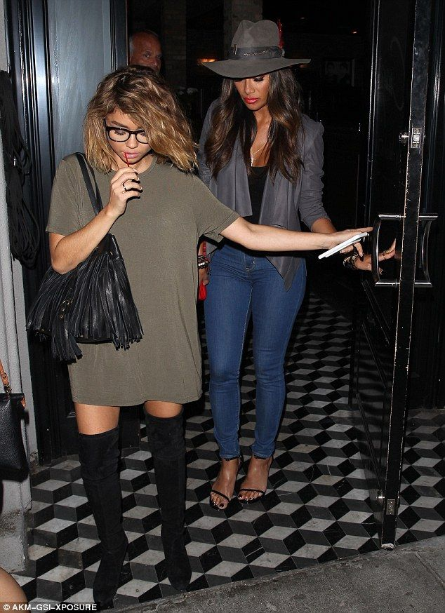 Here they come: Nicole Scherzinger was joined by actress Sarah Hyland as they made an exit from Hollywood restaurant Craig's on Tuesday evening