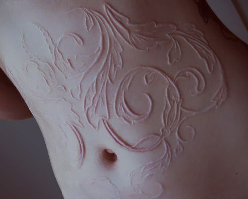 I see things like this and it makes me think. I really need to get more scarification done...