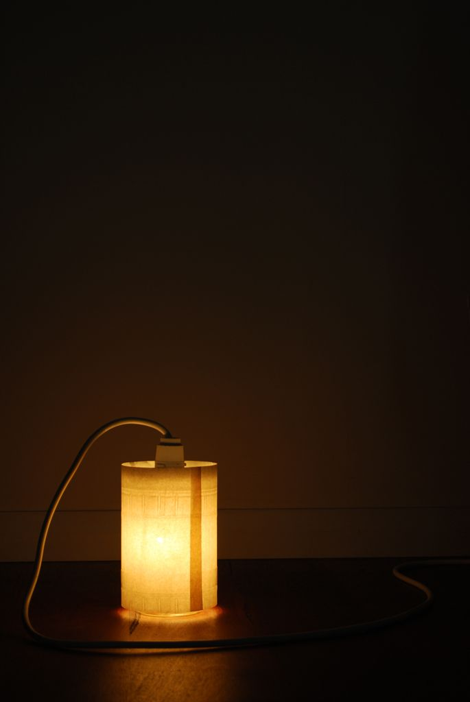 Glass jar with paper and a light