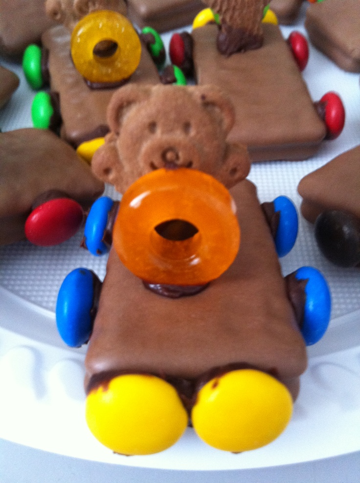 Racing cars! Great party idea! -Tim Tams -Smarties -Tiny Teddies -Lifesavers stuck together with icing. Yum!
