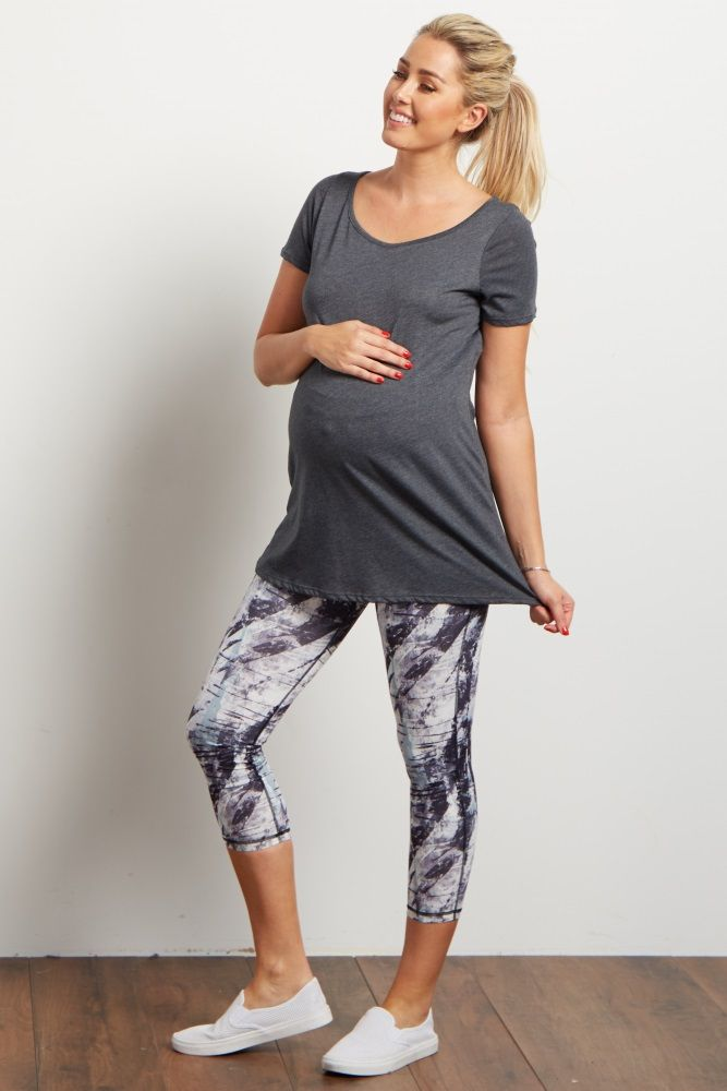 Mix up your boring active wear with these stylish printed maternity workout pants. A unique print guaranteed to keep your energy up all day long, with an elastic waistband for comfort. Pair these maternity workout pants with a solid maternity tank for a complete look.