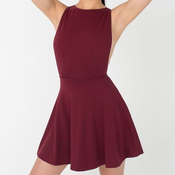 American Apparel Maroon Backless Skater Dress Near perfect condition. I couldn't find a good photo of a model in the dress, but it's one of their class is styles. Low cut back and cut low under the arms. Very flattering. Ask questions and make offers. American Apparel Dresses Mini