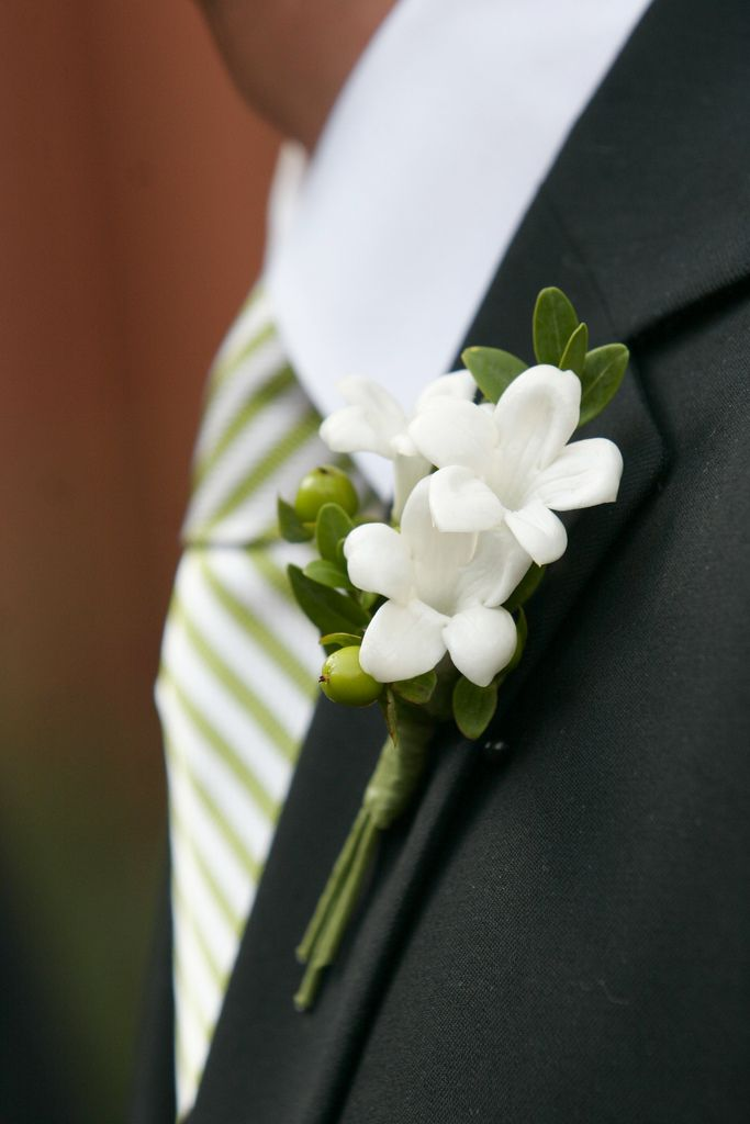 Boutonniere of Stephanotis, Hypericum Berries and greenery.