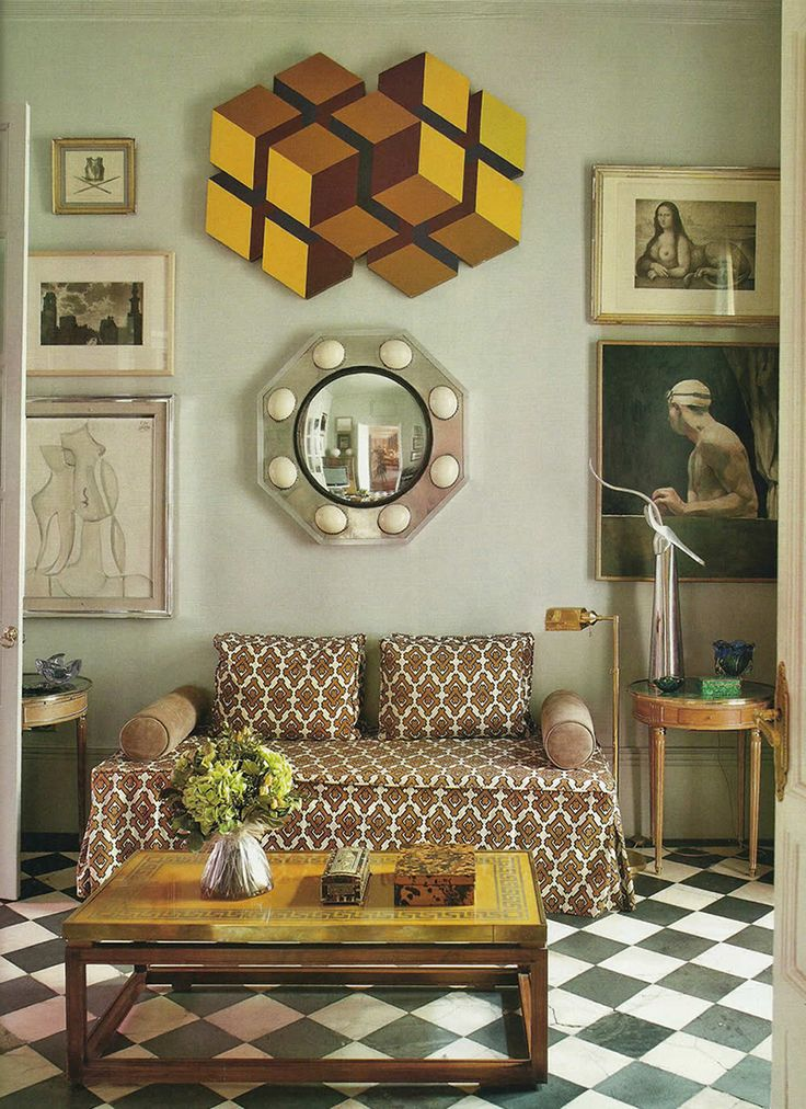 To see a colourful geometric artwork in an otherwise very classic interior is surprising, but that's why it works. Such an addition keeps a chic room from looking stuffy.