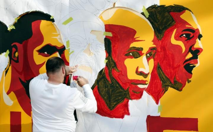 Greg Schade of Cleveland paints a Cleveland Cavaliers mural outside Quicken Loans Arena before the start of Game 3 of the NBA Finals between the Cleveland Cavaliers and the Golden State Warriors in Cleveland, Ohio