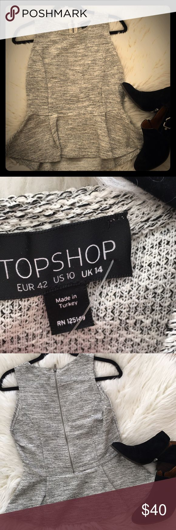 NWT Top Shop Black & White Peplum Top Sz 10. NWT Top Shop Black & White Peplum Top with zipper detail in the back. Purchased from Nordstroms and has original tag. Sz 10. Topshop Tops Blouses