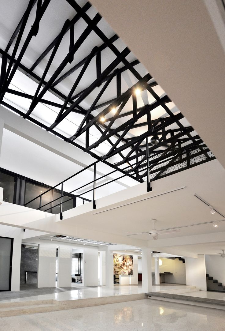 Terrace house living area converted into modern art gallery central area.