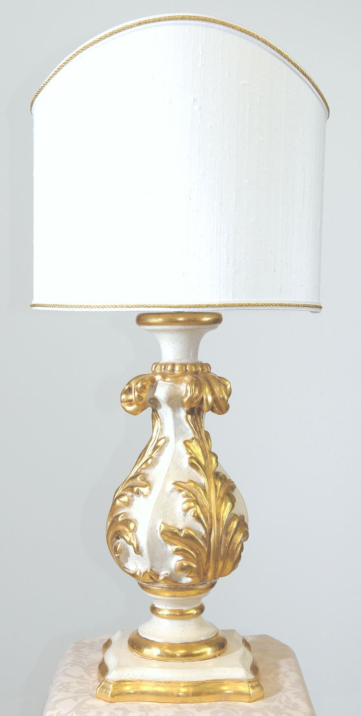 """""""Acantus"""" light base.  Carved wood, pure gold leaf gilt, laquered with natural pigments."""