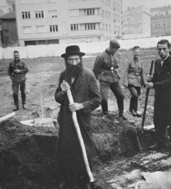 Jews forced to work in the Podgorze Ghetto (Krakow). The Germans liked to say how lazy Jews were