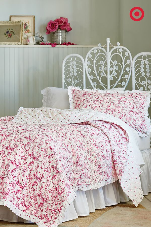 This paisley-and-floral print Simply Shabby Chic quilt is all it takes to bring life to a neutral bedroom. The quilt's ruffled edge adds a feminine touch, while a wrought-iron headboard brings an unexpected element of vintage detail.