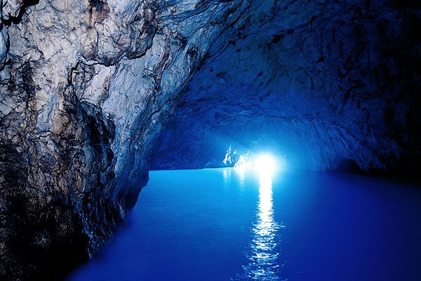 The Blue Grotto near Capri, Italy. A sea cave that is flooded with electric blue light. Take the rowboat tour or wait until they pack up for the day and swim in for free!