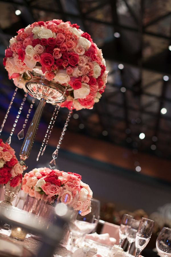Shades of pink and hanging crystals centerpiece for Flower arrangements for sweet 16
