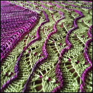 As a bottom-up, then sideways, shawl with an easy-to-memorize lace repeat, it goes a lot faster than the final product suggests!