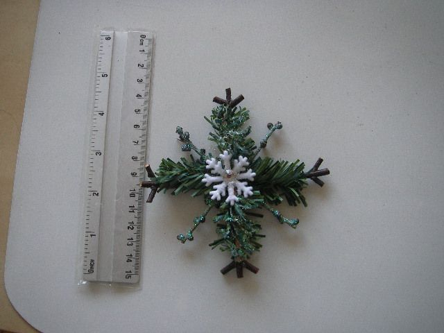 found the idea here  http://www.littlethingsbringsmiles.com/2010/12/rustic-snowflake-tutorial.html and made my own version
