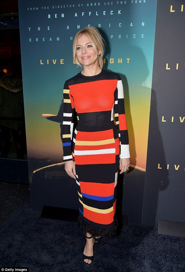 Colourful and chic: Sienna Miller slipped into yet another stylish ensemble for the New York screening of Live By Night at Metrograph on Tuesday