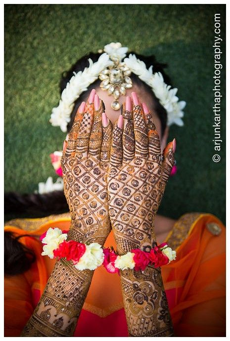 Hiding her face or showing off her mehandi???  Arjun Kartha Photography | Photos an Indian Bride Can't Miss in Her Wedding Album | http://arjunkarthaphotography.com