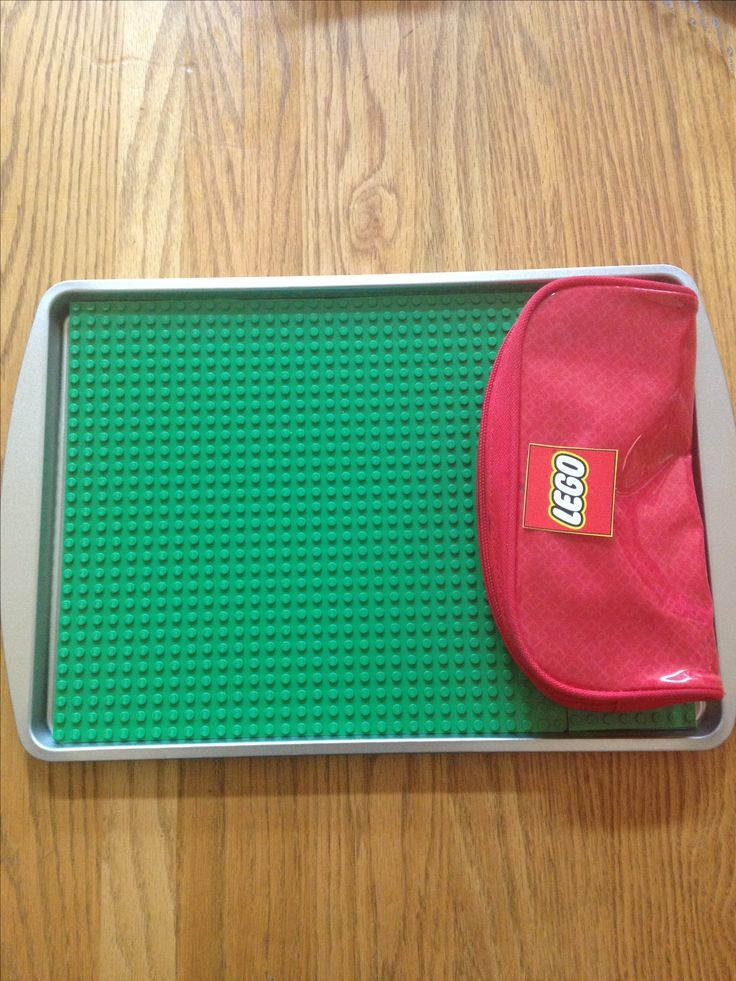 Lego board glued to dollar store cookie sheet and pencil holder. Road trip fun.